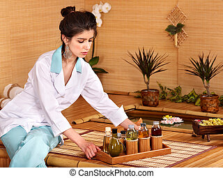 Bamboo massage at spa.