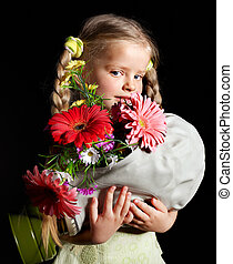 Child holding flowers and gas mask - Little girl holding...