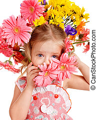 Child with with flowers on her hair. - Little cute girl with...