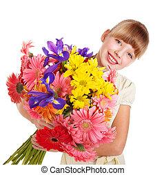 Happy child holding flowers.