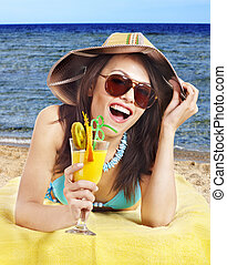 Girl in bikini on beach - Girl in bikini on beach drinking...