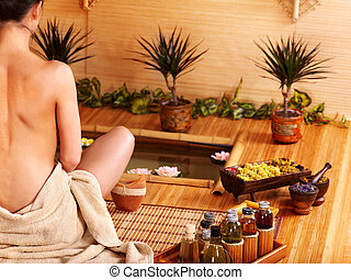 Bamboo massage at spa - Bamboo massage at spa and woman