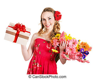 Young woman holding gift box and flowers - Happy young woman...