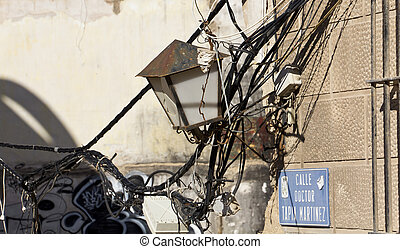 electric and telephone wires broken in an old house