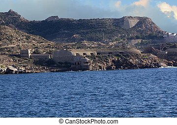 coast with ancient fortifications in Cartagena, Spain