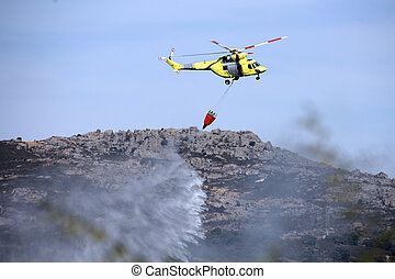 fire fighting helicopters fire on the mountain
