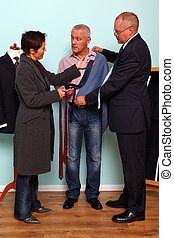 Husband and wife bespoke suit fitting - Photo of a man...
