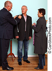 Man having a bespoke suit fitted.