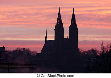 Prague old town - views on silhouette church at dawn,...