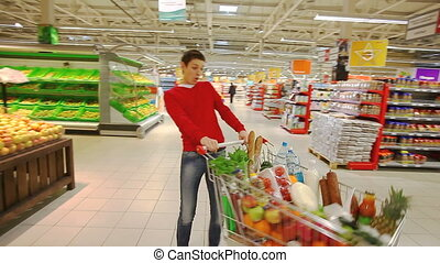 Fun at shopping mall - Cheerful young man having fun in...
