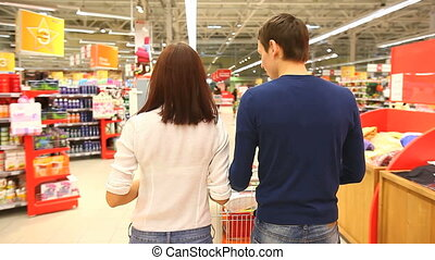 Couple at shopping centre - Couple walking through shopping...