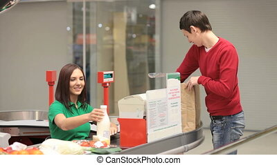 Buyer and cashier - Smiling man paying for products at the...