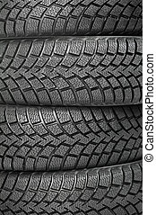 Background of four car wheel winter tires - Background of...