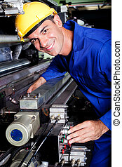 industrial machine operator at work - happy modern...