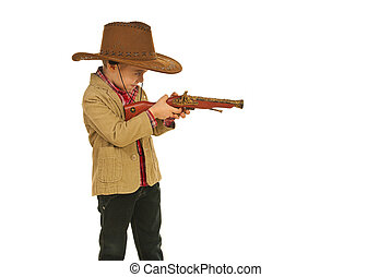 Little cowboy shooting with gun toy - Little cowboy shooting...