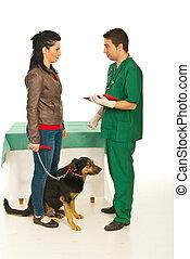 Vet man explaining owner treatment