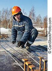 builder works with concrete reinforcement - Authentic worker...