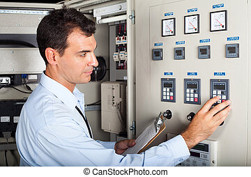 professional industrial engineer adjusting modern machine...