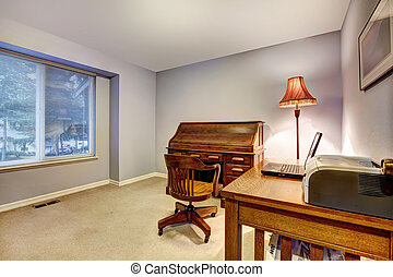 Home office with blue walls and wood funiture. - Simple...