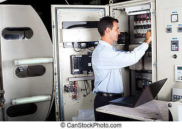 professional technician repairing industrial machine with...