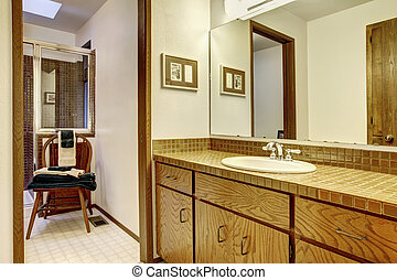 Outdated brown simple bathroom with one sink - Simple browns...