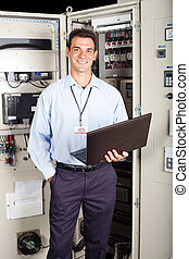 factory technician - portrait of modern factory technician...