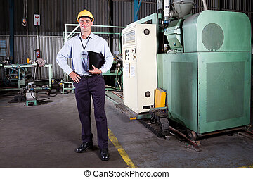 factory manager - full length portrait of a factory manager