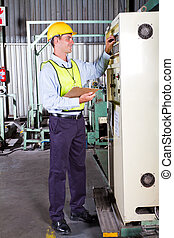 industrial machine operator setting up machine