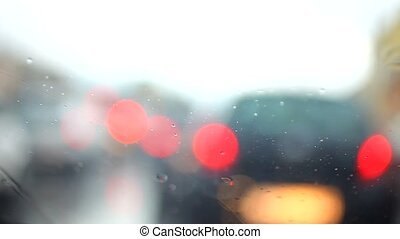 rain drops on the window and Car driving by day