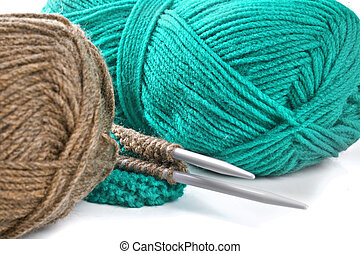 Woollen thread and knitting needle. Needlework accessories on white background.