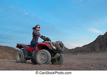 girl on atv - Pretty positive girl on atv on the desert...