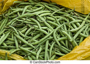 Green beans in a yellow plastic bag for sale in an Ethiopian...