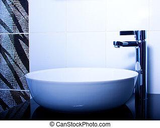 MODERN BATHROOM TAP - Black and white portrait of a modern...