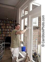 Painter at work - Painter painting in living room