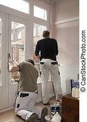 Painting job - Painters at work inside a home