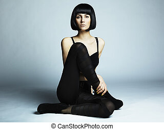 Fashion photo of young long-legged woman