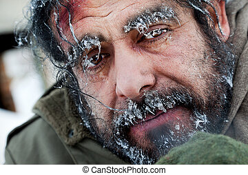 Homeless winter frozen face - Close-up of homeless male face...