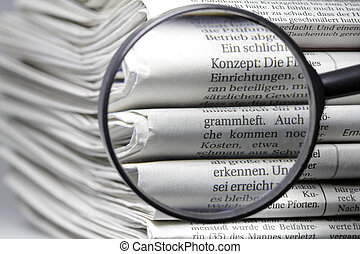 newspapers - Several newspapers on one another and form a...