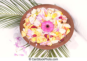 Wooden bowl with petals
