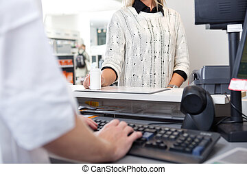 Customer Standing at Checkout Counter