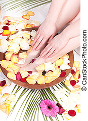 Pedicure and manicure spa with petals and flowers