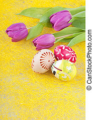 Painted eggs - Three painted easter eggs and the tulips