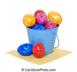 Easter eggs in a bucket on a white background