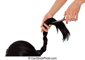 hairdresser cutting young woman with long black hair