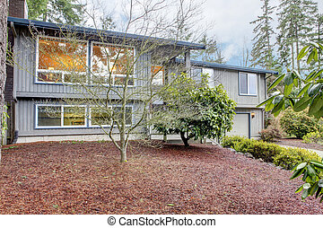 Simple grey brown split level American House. - Two story...