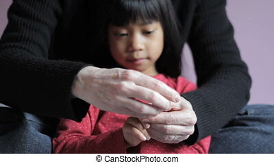 Mother Trims Daugters Fingernails - A cute little Asian 5...