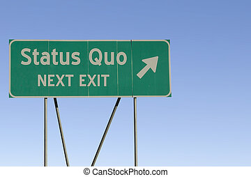 status quo - Next Exit Road - Green road sign with a blue...