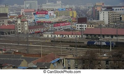 Long goods train traveling on railway at Taian City near...
