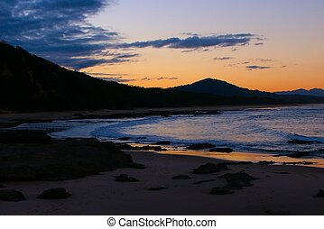 Nambucca Heads Australia - Sunset over evening waves at...
