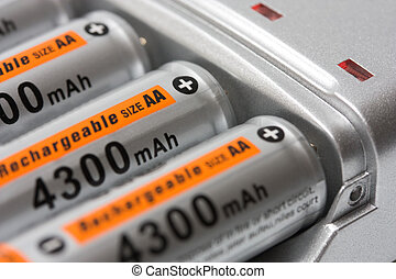 Battery charger with batteries AA background